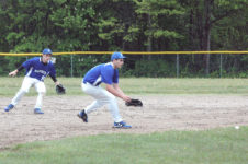 Nathan Winchester goes for the grounder against Jonesport. Photo by Jack Scott