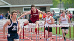 Alex Taylor-Lash runs the 110 meter hurdles. Photo by Sharon Catus