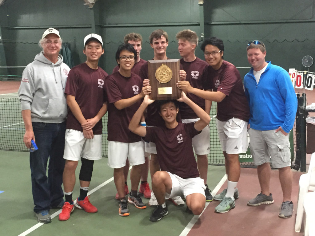 The Eagles varsity boys tennis team