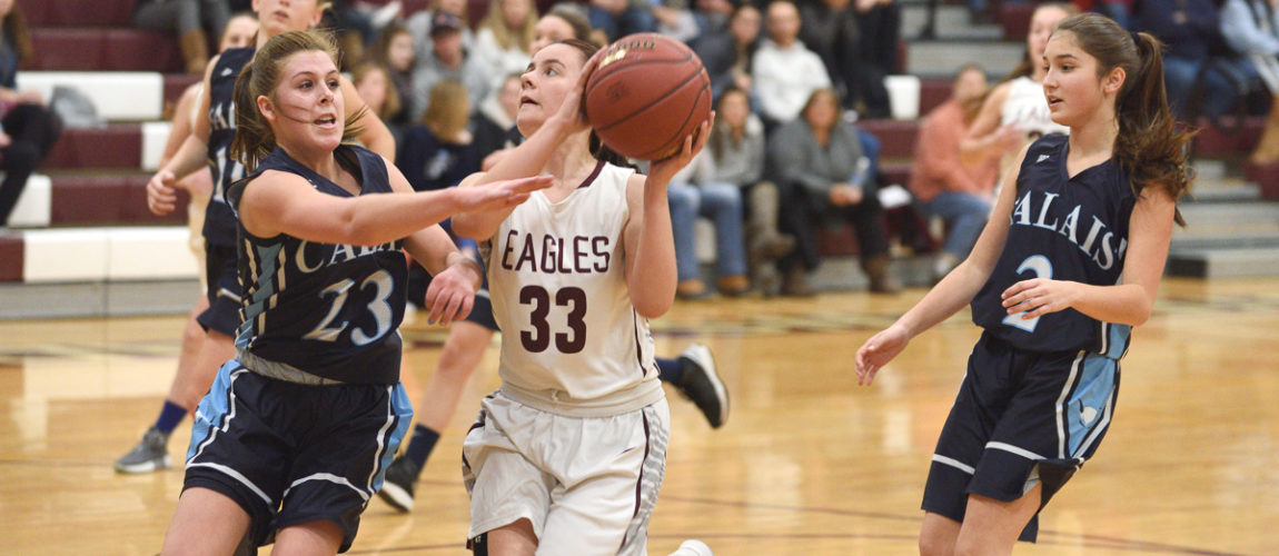 Eagle varsity boys basketball team cruises, girls falter